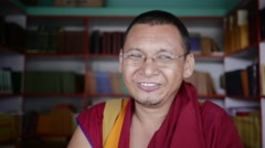 Happy Buddhist Monk librarian close up Stock Footage
