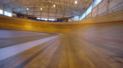 4K Competitive cyclists racing on track in velodrome - stock footage