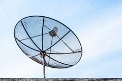 Satellite TV with blue sky - stock photo