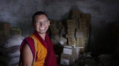 Happy Buddhist Monk szanding in dark room Stock Footage