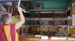 Buddhist Monk librarian closing bookstore Stock Footage