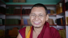 Happy Buddhist Monk librarian smiling Stock Footage