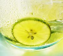 Green lemon with ice tea - bright colors Stock Photos