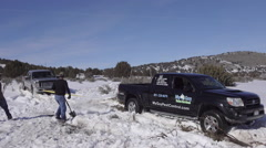 Stuck truck in winter snow tow out friends HD Stock Footage