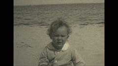 Vintage 16mm film, 1934, Ontario, Kawartha Lakes toddler on beach Stock Footage