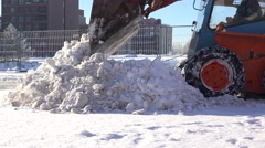 Automated snow removal with special equipment in urban parking. 4K Stock Footage