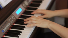 Two hands playing a gentle piece on a beautiful grand piano. Stock Footage