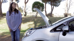 Desperate Women looking broken car engine on street asking for help Stock Footage