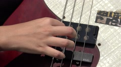 Fingers Plucking Bass Guitar Strings Stock Footage
