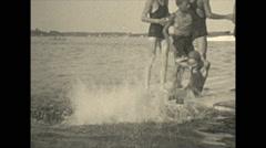 Vintage 16mm film, 1934, Ontario, Kawartha Lakes kids jumping off swim platform Stock Footage