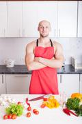 muscle man cooking - stock photo