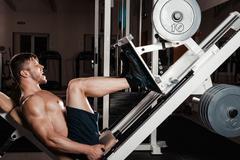 Muscular Man Doing Heavy Exercise Stock Photos