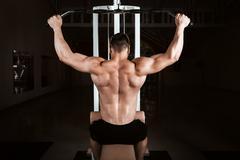 Muscular bodybuilder training back Stock Photos