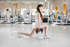 Girl works out with dumbbells Stock Photos