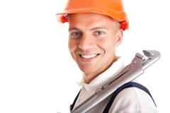Smiling handsome handyman - stock photo