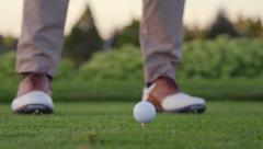 Golfer takes practice swings Stock Footage