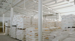 Bags with flour in warehouse of flour factory. Flour stock. Mill warehouse Stock Footage
