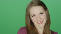Cute redhead being flirty and shy, on a green screen background Stock Footage