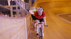 4K Team of competitive cyclists preparing to race in velodrome - stock footage