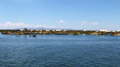 Long shot of the Uros Islands in Lake Titicaca Stock Footage
