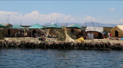 Small community on the Uros Islands near Puno Stock Footage