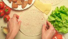 Girl cooking Caesar roll with flatbread, chicken, cheese, salad and tomatoes Stock Footage