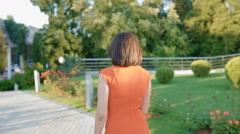 Mature caucasian woman walk in the park - stock footage