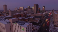 Nashville Snow- Dolly in to main city buildings - stock footage