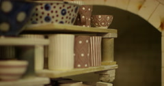 Shot of ceramics going into a kiln. Stock Footage