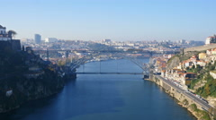 Arrabida bridge and moving train, Douro river, Porto, Portugal Arkistovideo