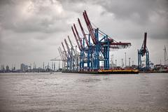 Hamburg port. Shipping vessels on a cloudy day. - stock photo