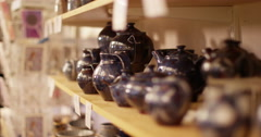 Dolly shot of a collection of pots ready to be sold. Stock Footage