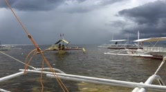 Catamaran Boats with dark clouds Stock Footage