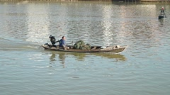 Boating fishermen fishing in river Stock Footage