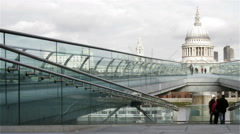 St. Pauls and the Millenium Bridge, London; panning, time lapse Stock Footage