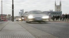 Early morning commuter rush hour; panning time lapse Stock Footage