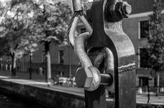 Old Metal Fastening and Bridge Hook in Amsterdam - stock photo