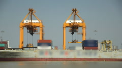 Cargo ship loading goods container at shipping port Stock Footage