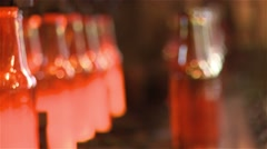 finished glass beer bottles still incandescente in production line - stock footage