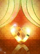 Wedding rings on yellow background Stock Illustration