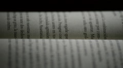 Pages of a old open book with words, phrases and texts in castillian, rotating Stock Footage