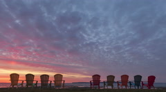 4K Time lapse zoom out Red Sunrise behind Chairs Stock Footage