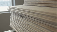 Line drawing oil from solid floor boards. RAW video record Stock Footage