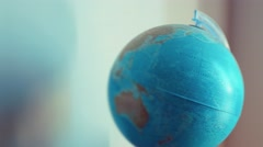 Handheld shot of World globe in interior Stock Footage