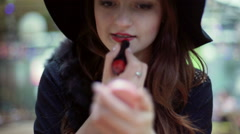 Glamorous woman using red lipstick and looking to the mirror Stock Footage