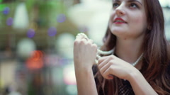 Beautiful woman looking thoughtful and wearing perls Stock Footage