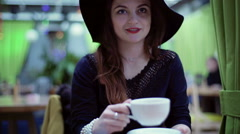 Glamorous woman holding cup and smelling the aroma, steadycam shot Stock Footage