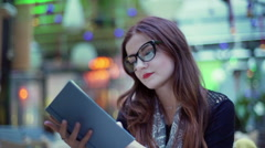 Beautiful woman wearing glasses and reading book Stock Footage
