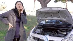 Camera moving towards woman calling for help after broken car engine Stock Footage