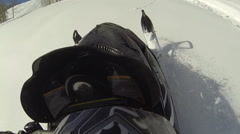 Snowmobile climb steep mountain forest POV HD Stock Footage